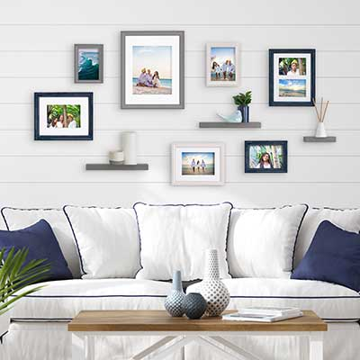 White couch featuring a plethora of photos above