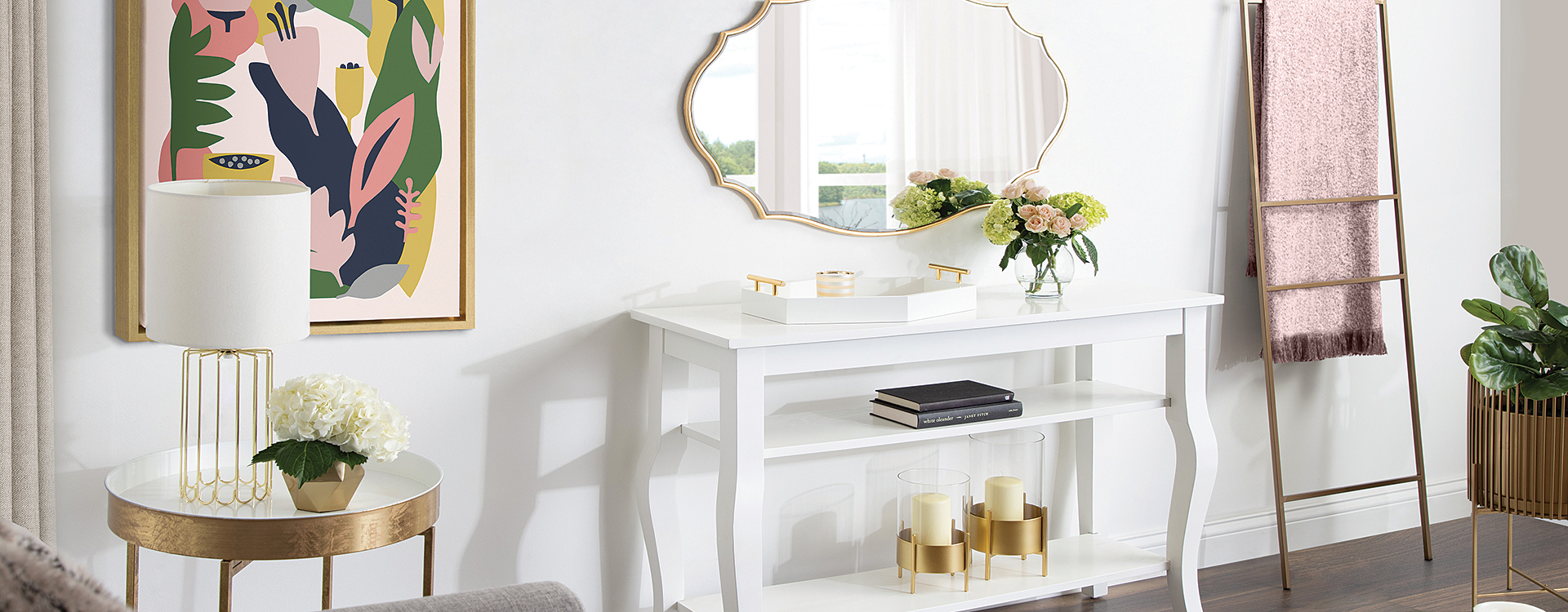 Room with white desk, mirror, and abstract art
