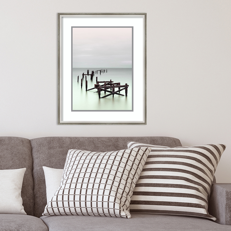 picture of abandoned dock above gray couch