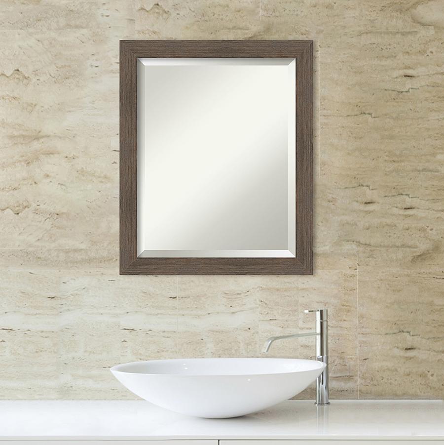 Dark wood framed mirror over sink