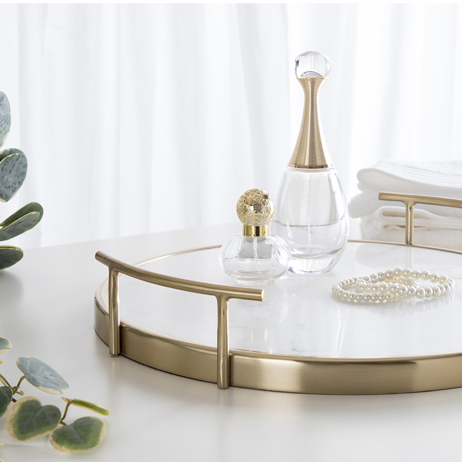 Stone and metal carrying tray with spritz bottles and pearls