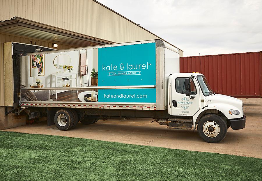 kate & laurel branded truck at warehouse