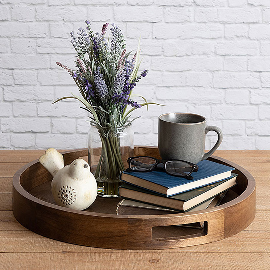 Decorative dark brown tray filled with items.