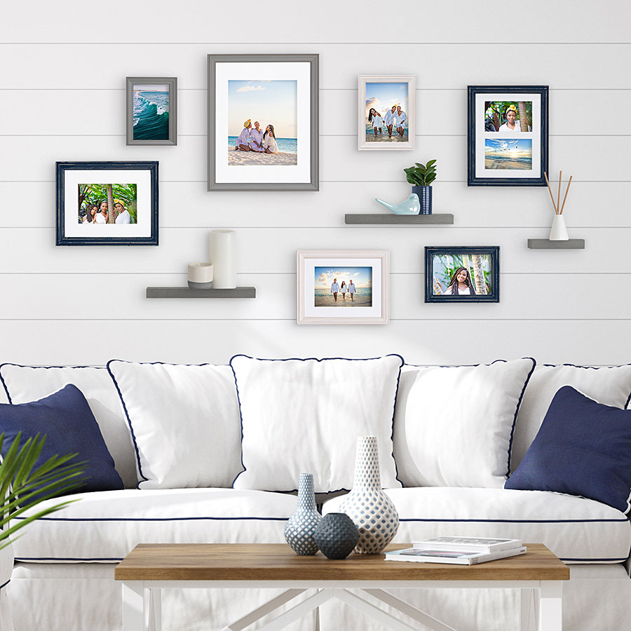 Couch with plethora of photos above it