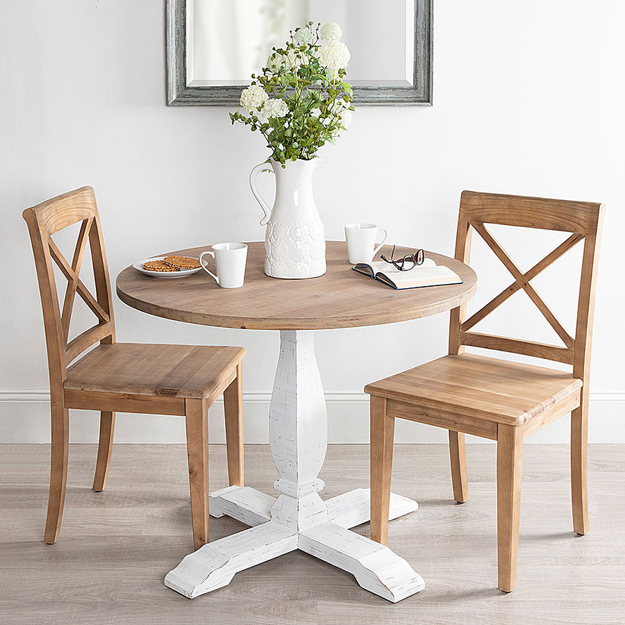 Wooden table with chairs and floral feature