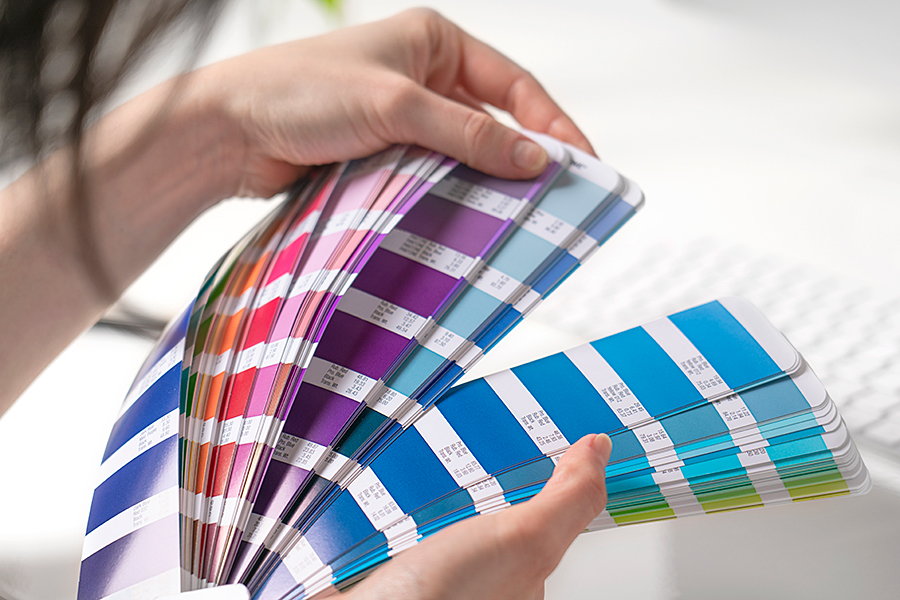 Person picking from an array of paint swatches