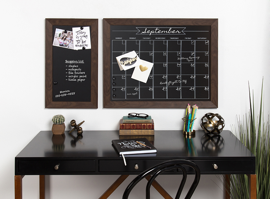 Calendar and organizer boards over table in black
